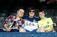 Fans wear old Southend United shirts in support of the club's Retro Day theme during the Sky Bet League 1 match between Southend United and MK Dons at Roots Hall, Southend, England on 21 April 2018. Photo by Carlton Myrie.