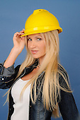 Stock Photo Attractive woman wearing construction gear