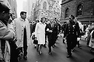 December 1967, Manhattan, New York City, New York State, USA. New York Governor Nelson Rockefeller and his wife Happy Rockefeller walk down Madison Avenue followed by security and the press.