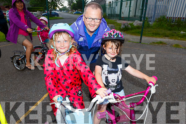 Emily Egan Smith and Edel Sweeney with John Murray of the Chain Gang doing a safety course on their bikes which is been run by the Tralee Chain Gang and the Kerry Recreation and Sports Partnership .
