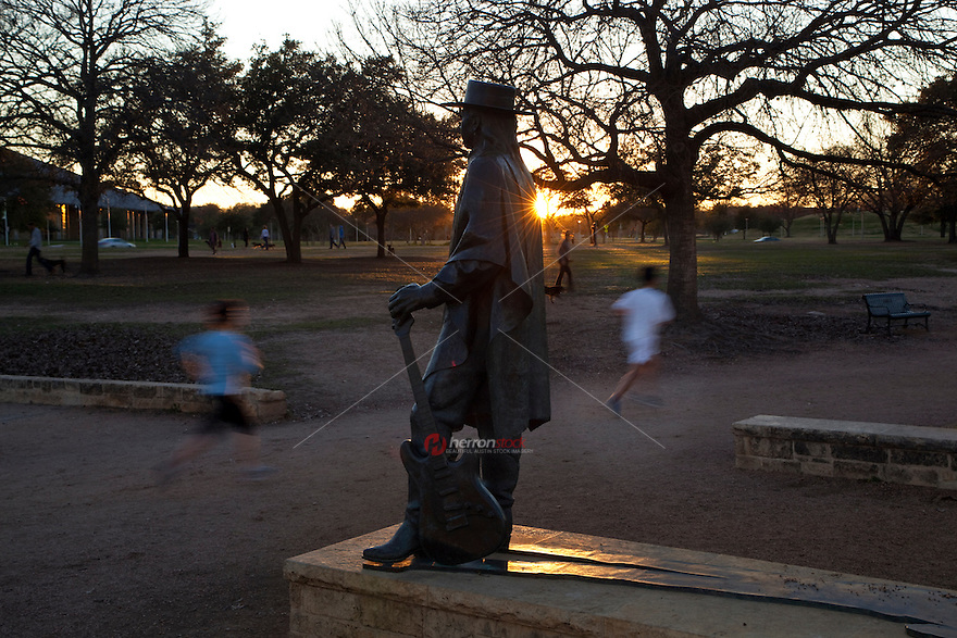 Stevie Ray Vaughan was embraced by Austin, Texas for the music he made at clubs in the city. Walkers, runners and joggers pass by the Stevie Ray Vaughan Memorial Statue as it is the city's most popular tourist attraction on Town Lake in Austin, Texas.