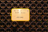 Champagne bottles stacked in an underground vaulted cellar closed with silver and green crown caps capsules in total 129956 bottles at Champagne Deutz in Ay, Vallee de la Marne, Champagne, Marne, Ardennes, France