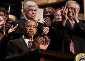 "United States President Barack Obama applauds after signing the the financial reform bill into law during a ceremony with Senate Banking Committee Chairman Christopher Dodd (D-CT) (C), House Financial Services Committee Chairman Barney Frank (D-MA) (R) and other memebers of Congress at the Ronald Reagan Building and International Trade Center Wednesday, July 21, 2010 in Washington, DC. A sweeping expansion of federal financial regulation in the wake of the worst recession since the Great Depression, the bill will create a consumer protection agency, lay out a blueprint for disassembling financial entities considered ""too big to fail,"" and many other  reforms.  .Credit: Chip Somodevilla - Pool via CNP"