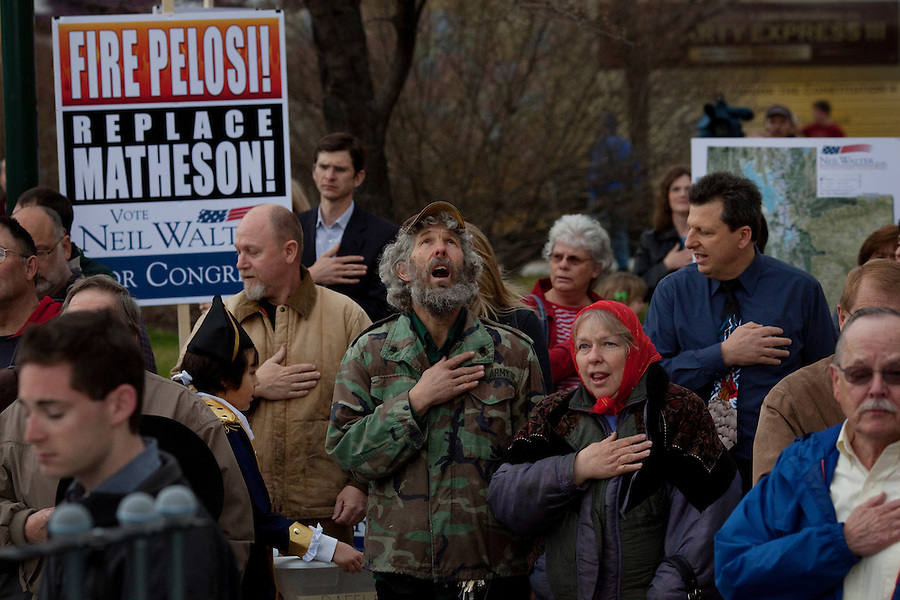 Provo, Utah, March 30, 2010 - Tea Party supporters hold their hand over their chest for the National Anthem during a rally outside the Historic Utah County Courthouse for the sixth stop in their 43 city tour across America..