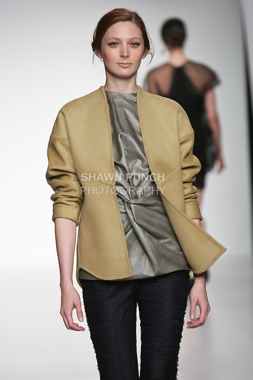 Model walks runway in an outfit from the Flight of Fancy collection by Elishah Rho, during the Pratt 2011 fashion show.