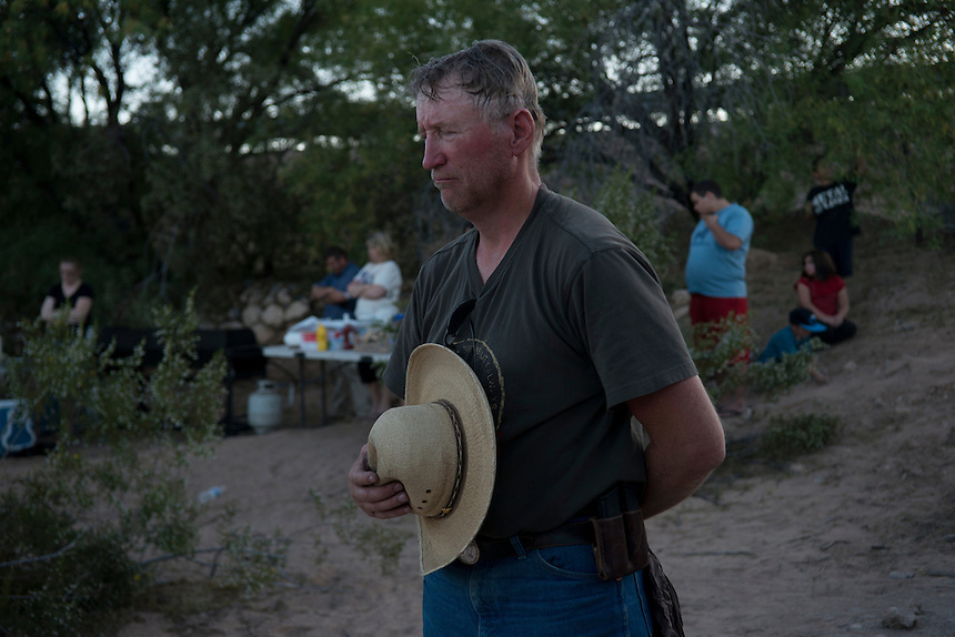A supporter of Cliven Bundy prays at a prayer gathering followed by a cookout provided by Bundy for his supporters near the Cliven Bundy ranch in Bunkerville, Nevada.<br />