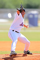 New York Mets minor league pitcher Angel Cuan #13 delivers a pitch during a spring training game vs the St. Louis Cardinals at the Roger Dean Complex in Jupiter, Florida;  March 24, 2011.  Photo By Mike Janes/Four Seam Images