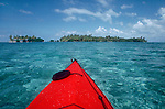 Belize, Lime Cay,  Sea Kayak, palm treed island, Belize Barrier Reef, Caribbean Sea, Lime Cay is off Placencia, Belize south coast,.