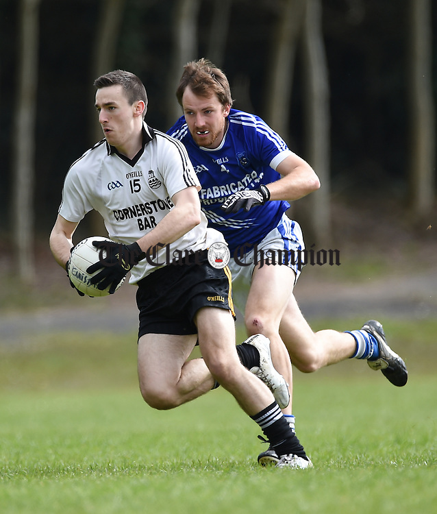 Sean Mc Conigley of Ennistymon in action against Caimin Deegan of Cratloe during their Cusack Cup game in Cratloe. Photograph by John Kelly.