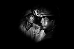 Potosi, Bolivia. Ernesto, 34, and Salvador, 24, working in their tunnel. The miners constantly chew coca leaves, helping them cope with the overwhelming strains and heat, and to prevent hunger.