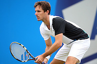 13.06.13 London, England. Edouard Roger-Vasselin during the The Aegon Championships from the The Queen's Club in West Kensington.