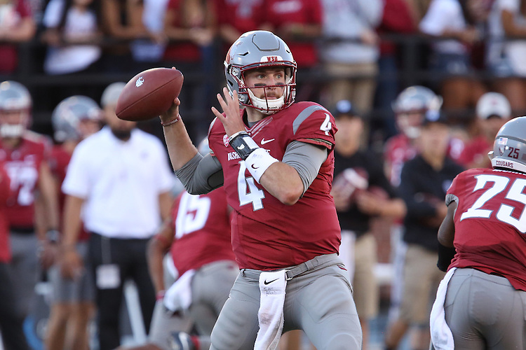 Luke Falk, Washington State University quarterback, finds an open receiver during the Cougars non-conference home opener at Martin Stadium against the Eastern Washington Eagles on September 3, 2016.