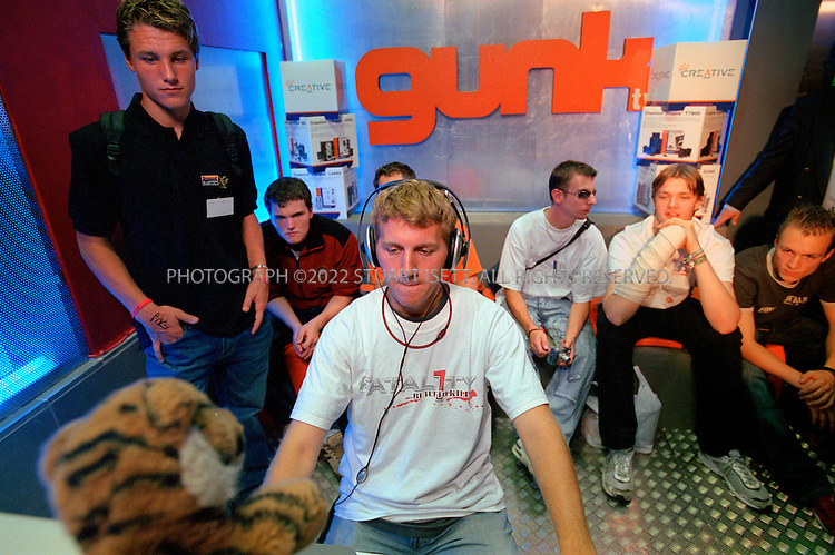 "9/22/2005--Antwerp, Belgium ..24 yr old American Jonathan ""Fatal1ty"" Wendel is the ""golden boy"" star of first person shooter (FPS) games; he is known as the best PC gamer in the world. Gaming tournaments are getting big and are increasingly attracting more coverage on TV. 'Fata1ty wants gaming to be treated as a sport, and pro-gamers to be known as ""E-Sportsmen/women""...Here he meets fans, signs autographs and plays exhibition matches against local Belgian talent at the Gunk Store in Antwerp, playing the game 'Painkiller'...Photograph By Stuart Isett.All photographs ©2005 Stuart Isett.All rights reserved."