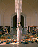 OMAN, Muscat, Barr Al Jissah Resort and Spa, Bellboy standing in hotel, portrait
