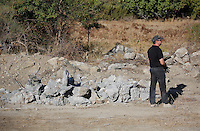 Pictured: A forensics officer at the new search site in Kos, Greece. Sunday 09 October 2016<br />