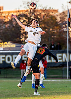 COLLEGE PARK, MD - NOVEMBER 03: Carlos Tellez #6 of Michigan goes up high for a header during a game between Michigan and Maryland at Ludwig Field on November 03, 2019 in College Park, Maryland.