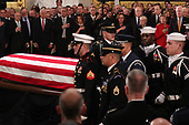 The casket of former U.S. President George H.W. Bush arrives to lie in state in the U.S. Capitol Rotunda as members of the House and Senate leadersip look on in Washington, U.S., December 3, 2018. REUTERS/Jonathan Ernst/Pool