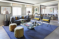 The spacious living room includes a pair of Miles van der Rohe chairs