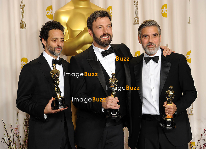 (left to right) Grant Heslov, Ben Affleck and George Clooney with the Oscar for Best Picture for Argo at the 85th Academy Awards at the Dolby Theatre, Los Angeles.
