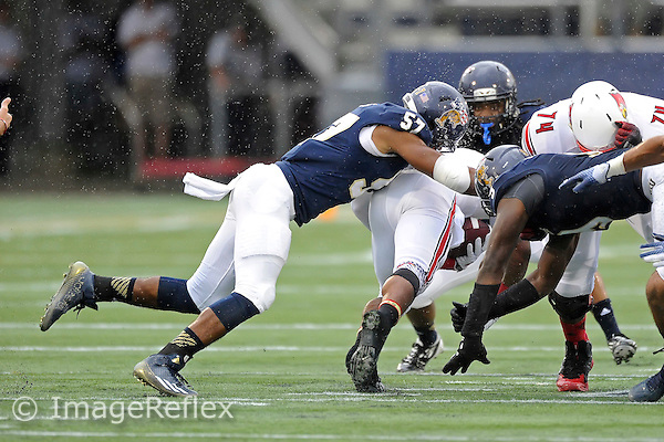 20 September 2014:  FIU linebacker Jordan Guest (57) tackles the Louisville ball carrier in the first half as the University of Louisville Cardinals defeated the FIU Golden Panthers, 34-3, at FIU Stadium in Miami, Florida.
