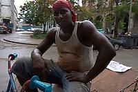 bicycle driver in street scene in Havana, Cuba