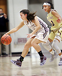 NAUGATUCK CT. 11 December 2018-121018SV13-#5 Shannon Burns of Naugatuck tries to keep the ball inbounds as #13 Mikayla Mobley of Sacred Heart defends during 2nd quarter NVL basketball action in Naugatuck Tuesday.<br /> Steven Valenti Republican-American