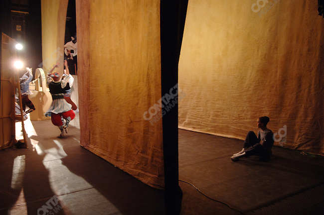 Nataliya Osipova, a soloist with the Bolshoi Ballet, warmed up next to the stage before her performance in Massine's Les Presages at the Bolshoi Theatre's New Stage in Moscow as a performance of another Massine ballet, Le Tricorne, came to a close. Moscow, Russia, January 25, 2007