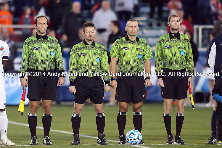 12 December 2014: Match officials. From left: Assistant referee Claudiu Badea, fourth official Edvin Juresivic, referee Chris Penso, assistant referee Cory Richardson. The University of Virginia Cavaliers played the University of Maryland Baltimore County Retrievers at WakeMed Stadium in Cary, North Carolina in a 2014 NCAA Division I Men's College Cup semifinal match.