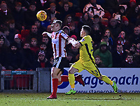 Lincoln City's Harry Anderson vies for possession with Cheltenham Town's Ilias Chatzitheodoridis<br /> <br /> Photographer Andrew Vaughan/CameraSport<br /> <br /> The EFL Sky Bet League Two - Lincoln City v Cheltenham Town - Tuesday 13th February 2018 - Sincil Bank - Lincoln<br /> <br /> World Copyright &copy; 2018 CameraSport. All rights reserved. 43 Linden Ave. Countesthorpe. Leicester. England. LE8 5PG - Tel: +44 (0) 116 277 4147 - admin@camerasport.com - www.camerasport.com