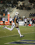 Nevada quarterback Tyler Stewart rushes for a touchdown during the second half of an NCAA college football game against UC Davis in Reno, Nev. on Thursday, Sept. 3, 2015. Nevada won 31-17. (AP Photo/Cathleen Allison)