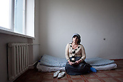 Roza Vakayeva, photographed in her room at the temporary housing facilities in the outskirts of Grozny. Grozny, Chechnya, Russia, 2010