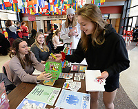Sandra Decaigny (right), an undergraduate student at the University of Arkansas from Dallas, picks out a prize Wednesday, Feb. 12, 2020, with help from Courtney White (left), an undergraduate student from Jonesboro, as she visits the Counseling and Psychological Services booth at the Relationships are Sweet Activity Fair in the Arkansas Union on the university campus in Fayetteville. The annual event provides information about creating and maintaining healthy relationships and offers exposure to counseling services that are available to the campus community. Visit nwaonline.com/200213Daily/ for today's photo gallery.<br /> (NWA Democrat-Gazette/Andy Shupe)
