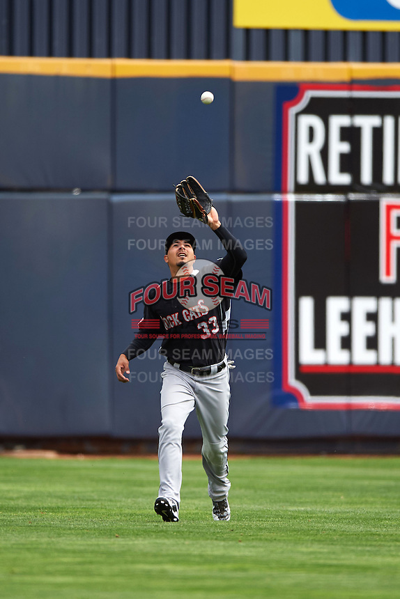 New Britain Rock Cats outfielder Noel Cuevas (33) catches a fly ball during a game against the Akron RubberDucks on May 21, 2015 at Canal Park in Akron, Ohio.  Akron defeated New Britain 4-2.  (Mike Janes/Four Seam Images)