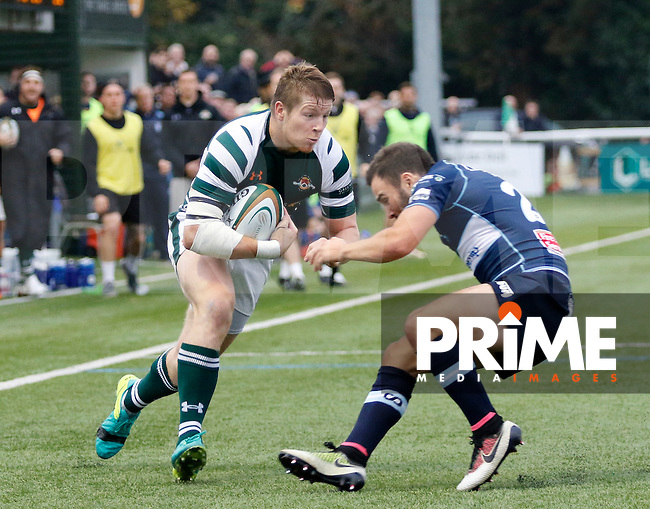 Ealing's James Cordy-Redden takes on Bedford's Jordan Burns during the Greene King IPA Championship match between Ealing Trailfinders and Bedford Blues at Castle Bar , West Ealing , England  on 29 October 2016. Photo by Carlton Myrie / PRiME Media