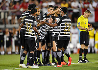 Orlando, FL - Saturday Jan. 21, 2017: Corinthians midfielder Paulo Roberto (28) is congratulated by his teammates waiting at midfield after a successful penalty shot during the penalty kick shootout of the Florida Cup Championship match between São Paulo and Corinthians at Bright House Networks Stadium. The game ended 0-0 in regulation with São Paulo defeating Corinthians 4-3 on penalty kicks.
