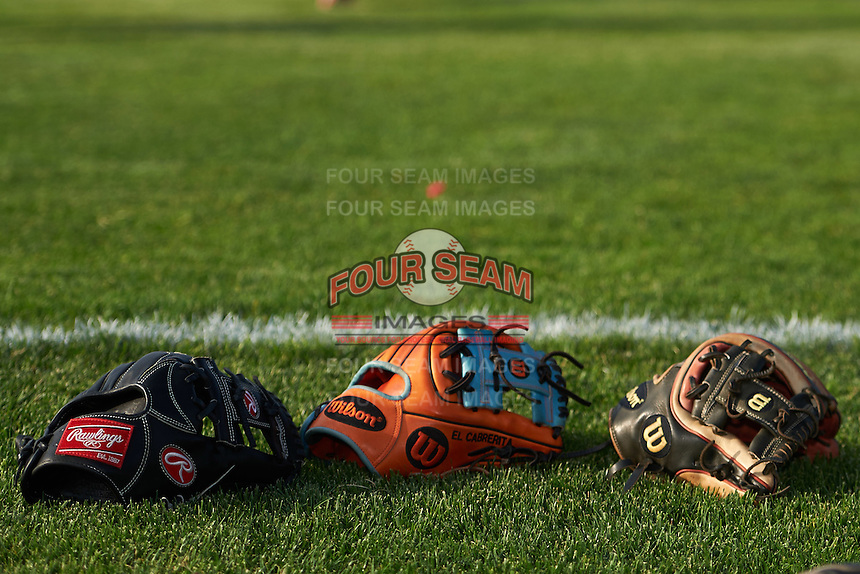 Batavia Muckdogs Rawlings and Wilson gloves on the field before a game against the Brooklyn Cyclones on July 6, 2016 at Dwyer Stadium in Batavia, New York.  Batavia defeated Brooklyn 15-2.  (Mike Janes/Four Seam Images)