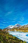 Resurrection Peaks and half frozen Lost Lake, Chugach National Forest, Kenai Peninsula, Southcentral Alaska, Spring. Vertical.