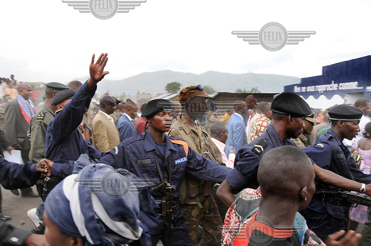 Police and bodyguards surround President Joseph Kabila on his visit to Goma..