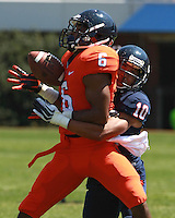 Virginia wide receiver Darius Jennings (6) misses the catch because of good defense from Virginia cornerback C.J. Moore (10) during the annual Virginia football Orange-Blue Spring Game Saturday at Scott Stadium in Charlottesville, VA. Photo/The Daily Progress/Andrew Shurtleff