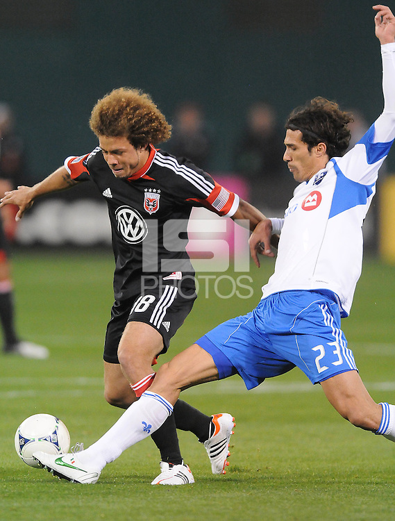 Montreal Impact forward Bernado Corradi (23) goes against D.C. United midfielder Nick DeLeon (18) D.C. United tied The Montreal Impact 1-1, at RFK Stadium, Wednesday April 18 , 2012.