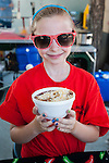 Sidney Fox, 9, shows off Hillbilly Chili during Legends of the West in Carson City, Nev., on Saturday June 22, 2013.<br /> (Photo by Kevin Clifford/Nevada Photo Source)