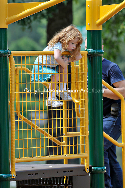 TORRINGTON, CT - 16 July 2012-071612EC03--   Wold Art.  Elexa Evangelisti, 3, climbs to the top of the playground while getting help from her dad at the William L. Besse Municipal Park Monday afternoon.  Erin Covey Republican-American.