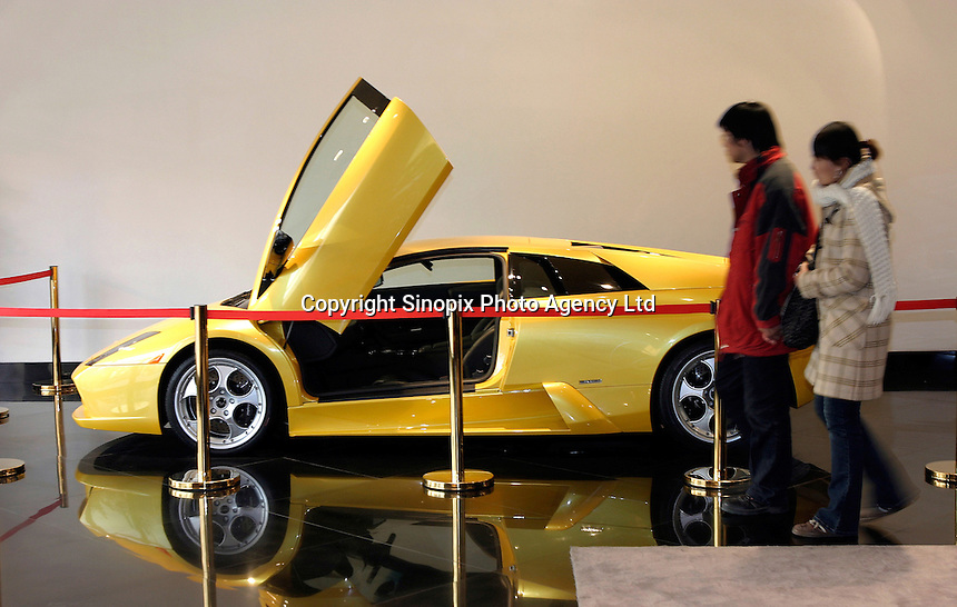 A couple looks at the RMB3.98 millions (US$479,518) Murcielago at the first Lamborghini showroom in Beijing, China..