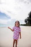 INDONESIA, Mentawai Islands, Kandui Surf Resort, girl standing on the beach