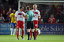 James Dunne of Stevenage and Mark Roberts of Stevenage protest about Southampton's second goal with referee Oliver Langford. Stevenage v Southampton - Capital One Cup Second Round - Lamex Stadium, Stevenage - 28th August, 2012. © Kevin Coleman 2012