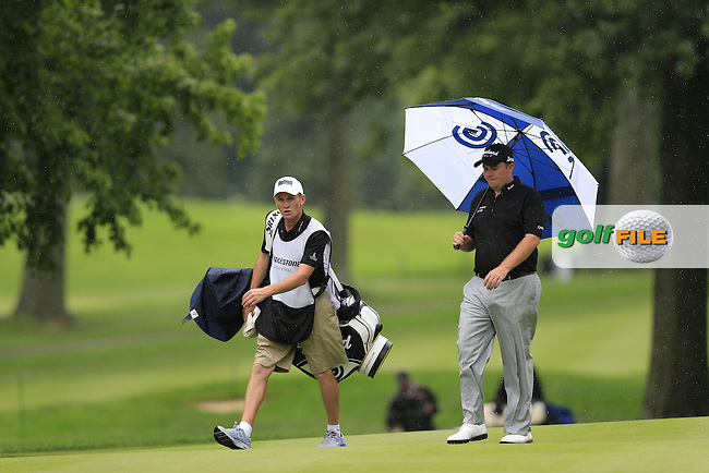 Shane Lowry (IRL) and caddy Dermot Byrne walk to the 8th green during Friday's Round 1 of the 2013 Bridgestone Invitational WGC tournament held at the Firestone Country Club, Akron, Ohio. 2nd August 2013.<br /> Picture: Eoin Clarke www.golffile.ie