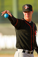 Delmarva Shorebirds starting pitcher Dylan Bundy #7 warms up with a weighted ball prior to the game against the Kannapolis Intimidators at CMC-Northeast Stadium on April 11, 2012 in Kannapolis, North Carolina.  (Brian Westerholt/Four Seam Images)