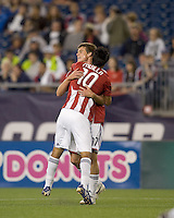 Two goal scorer Chivas USA midfielder Jesus Padilla (10) celebrates goal by Chivas USA forward Justin Braun (17). Chivas USA defeated the New England Revolution, 4-0, at Gillette Stadium on May 5, 2010.