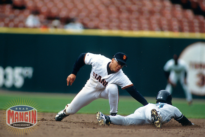SAN FRANCISCO, CA - Royce Clayton of the San Francisco Giants tags out a base runner at second base during a game at Candlestick Park in San Francisco, California in 1995. Photo by Brad Mangin