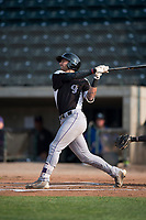 Grand Junction Rockies designated hitter Niko Decolati (16) follows through on his swing during a Pioneer League game against the Missoula Osprey at Ogren Park Allegiance Field on August 21, 2018 in Missoula, Montana. The Missoula Osprey defeated the Grand Junction Rockies by a score of 2-1. (Zachary Lucy/Four Seam Images)
